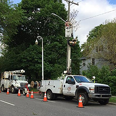Service Workers maintaining public lighting
