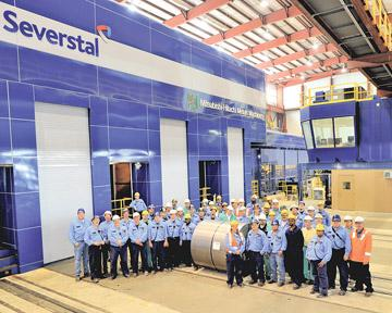 Severstal Steel employees gather near the first coil