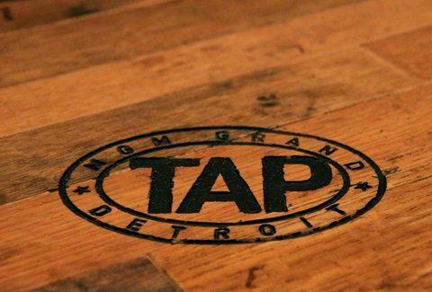 Tap logo from table at MGM Detroit