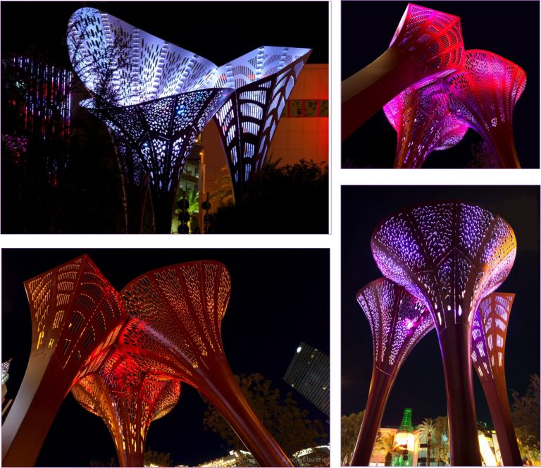 Oversized color changing LED lighted flowers line The Park pathway in Las Vegas