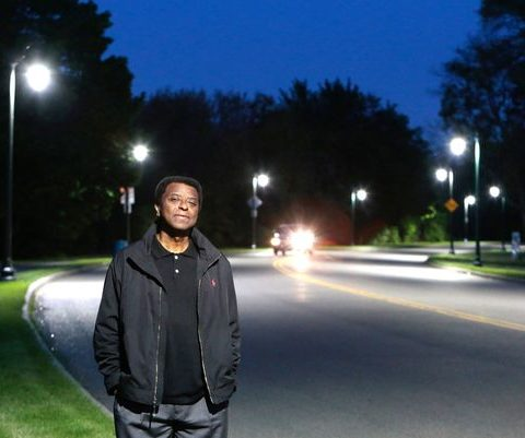 Man appreciating public lighting in Detroit